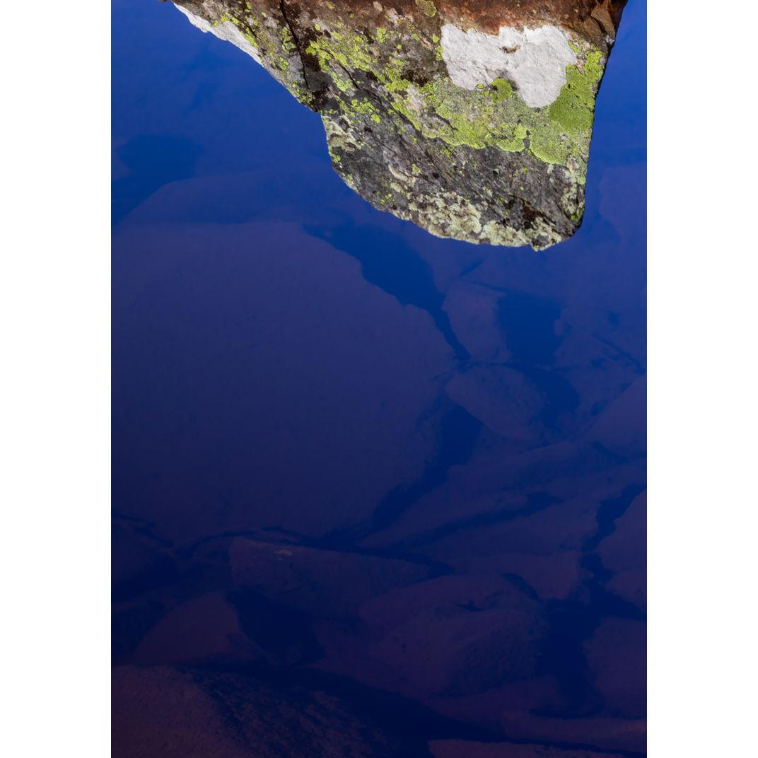 Rock formations' shapes reflected on lake Kvitåvatn by Romulo TIJERO