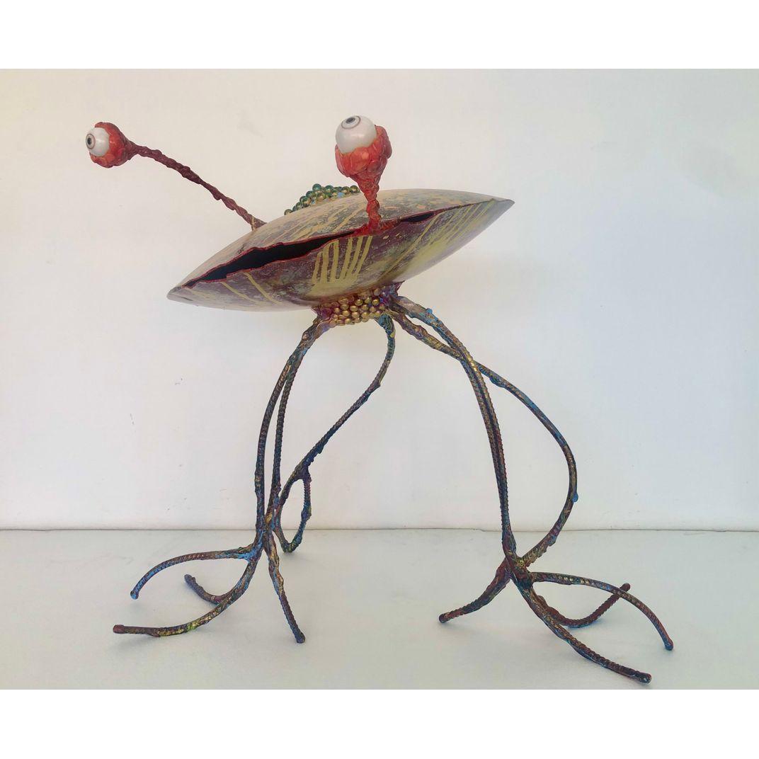 UFO by Komkrit Tepthian