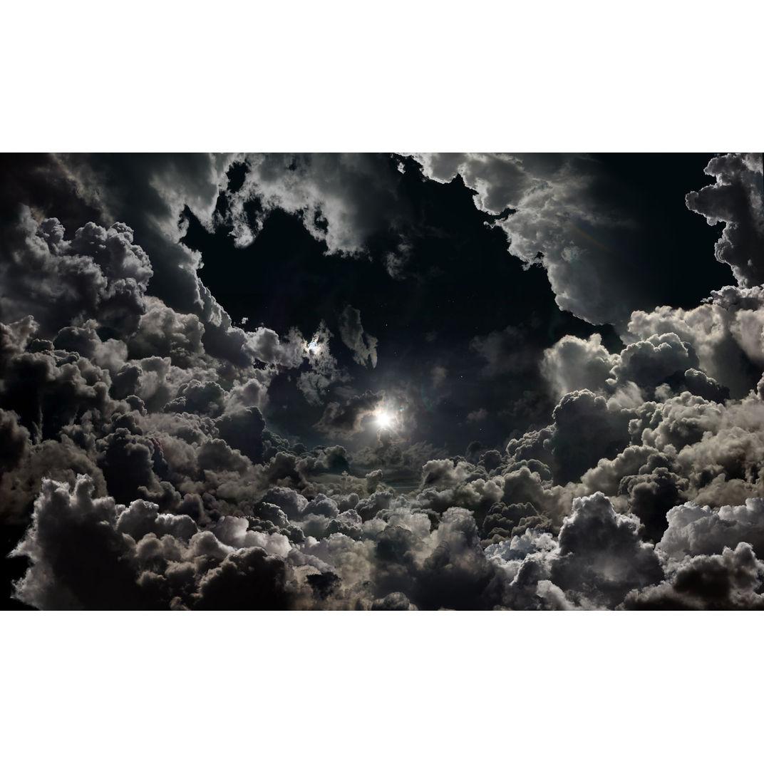 THE KINGDOM Moon above clouds by Seb Janiak