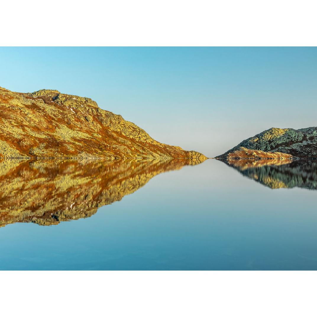 When two mountains meet at Djupetjønn lake by Romulo TIJERO