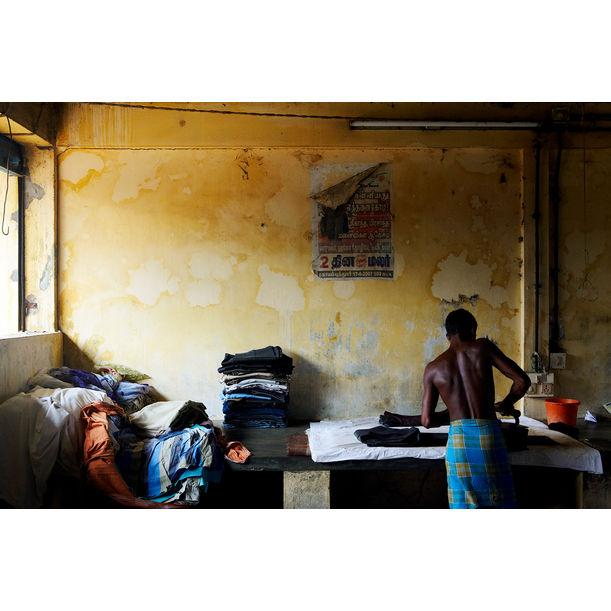Man Ironing, Fort Kochi by Ty Mecham