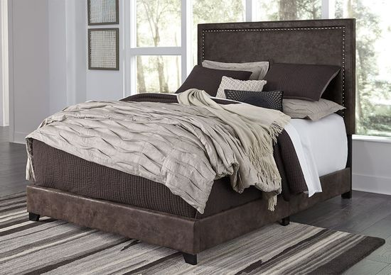 Picture of Dolante Brown Queen Upholstered Bed Set