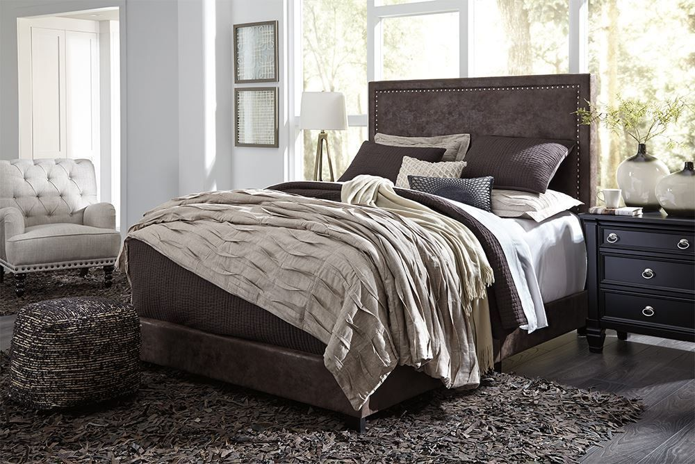 Picture of Dolante Brown King Upholstered Bed Set