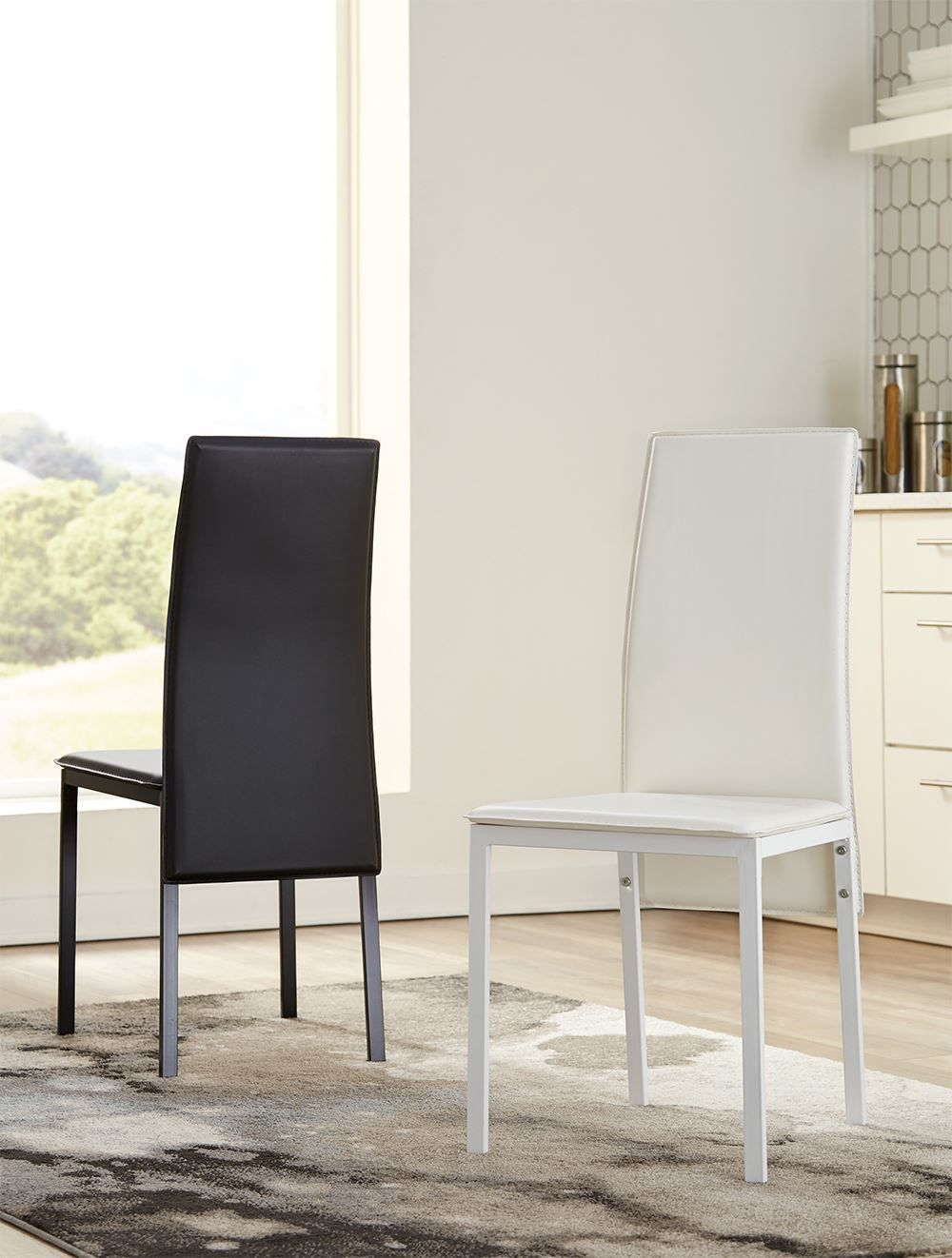 Picture of Sariden Table with Two Black Chairs and Two White Chairs