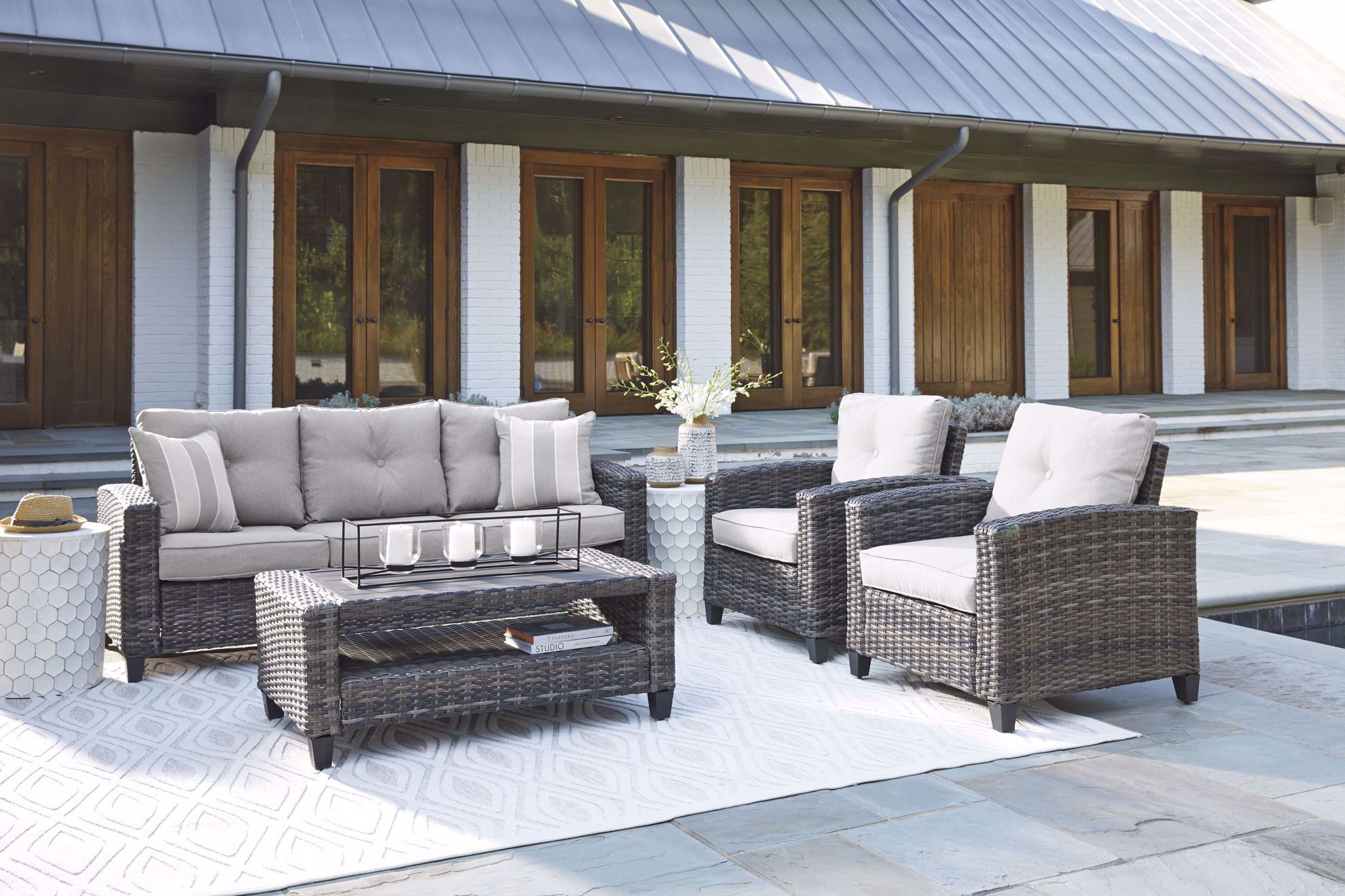 Picture of Cloverbrooke Sofa, 2 Chairs, and Cocktail Table Patio Set