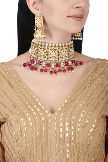 Gold plated kundan and red beads choker necklace set by AURAA TRENDS