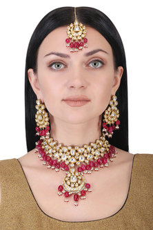 Gold plated kundan and red beads necklace set by AURAA TRENDS