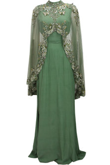 Green cutout goddess gown with embroidered high low sheer cape by Elysian By Gitanjali