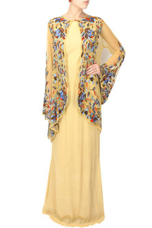 Beige queen bee gown with floral embroidered sheer cape by Elysian By Gitanjali