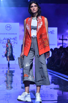 Orange Machine & Hand Embroidered Jacket by Shahin Mannan