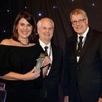 Herminia Ibarra accepts the 2013 Leadership Award from Executive Networks sponsors Mike Dulworth and Terry Shea