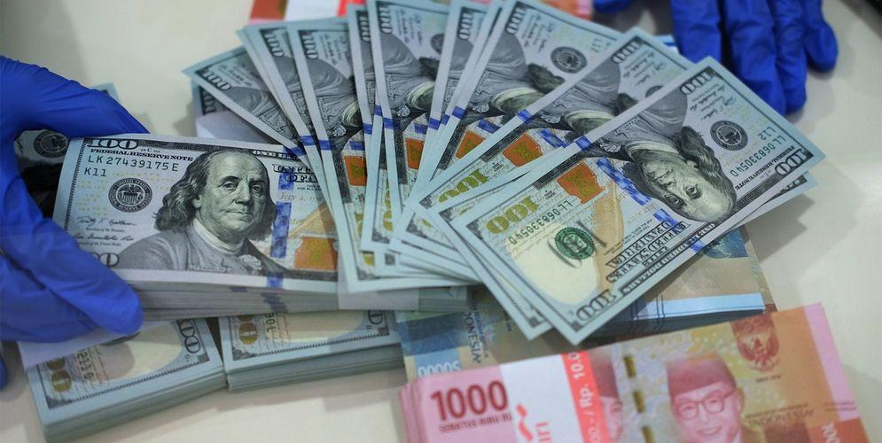 Bank Indonesia (BI) mencatat, hingga minggu ketiga November 2020, aliran modal asing yang keluar atau capital outflow mencapai Rp141,13 triliun. / Foto: Ismail pohan – Tren Asia\n