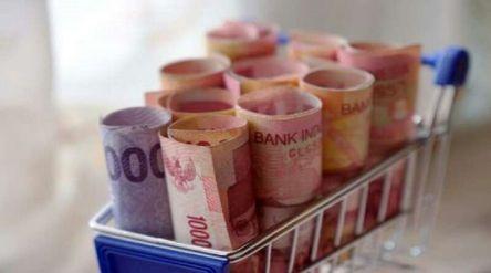 Ilustrasi uang rupiah di bank / Shutterstock\n