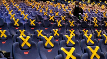 Petugas membersihkan area teater bioskop CGV di Mal Grand Indonesia, Jakarta, Rabu, 21 Oktober 2020....