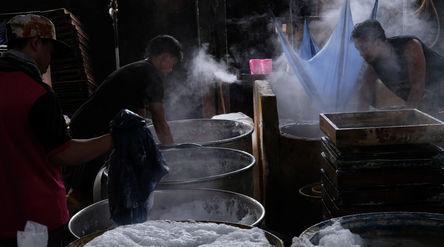 Pekerja menyelesaikan proses pembuatan tahu di industri rumahan kawasan Duren Tiga, Jakarta Selatan,...