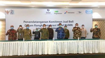 Penandatanganan Perjanjian Komitmen Jual Beli Saham untuk pembentukan holding hotel BUMN. / Dok. PT ...