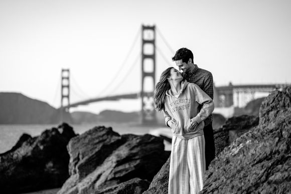 Lindsay and Aaron with Golden Gate Bridge in black and white.