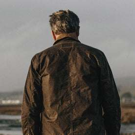 Our fit model wearing The Long Haul Jacket in Tobacco Waxed Canvas.