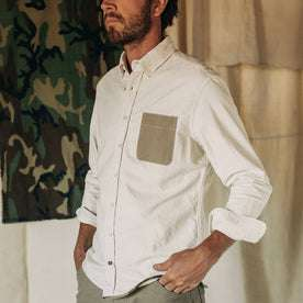 fit model wearing The Atelier and Repairs Jack in Washed White Oxford, cuffed, hands in pockets