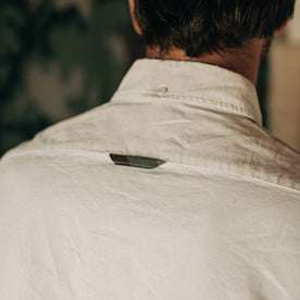 fit model wearing The Atelier and Repairs Jack in Washed White Oxford, back detail