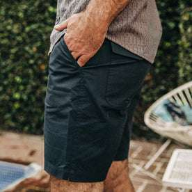 fit model wearing The Adventure Short in Navy from Taylor Stitch, hand in pocket