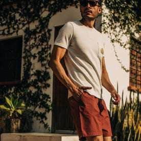 fit model wearing The Adventure Short in Rust, hand in pocket