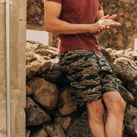 fit model wearing The Adventure Short in Tiger Camo, hands clasped