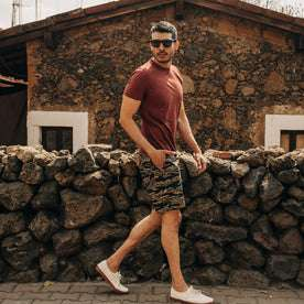 fit model wearing The Adventure Short in Tiger Camo, walking right