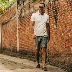 fit model wearing The Apres Short in Olive Pin Dot, walking down street