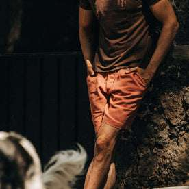 fit model wearing The Apres Short in Rust Hemp, hands at sides, chest down