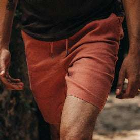 fit model wearing The Apres Short in Rust Hemp, hands at sides