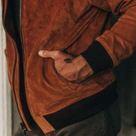fit model wearing The Bomber Jacket in Whiskey Suede, hand in side pocket