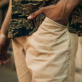fit model wearing The Camp Pant in Khaki Herringbone, hand in pocket, cropped up close