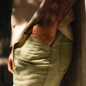 fit model wearing The Camp Pant in Olive Herringbone, hand in pocket
