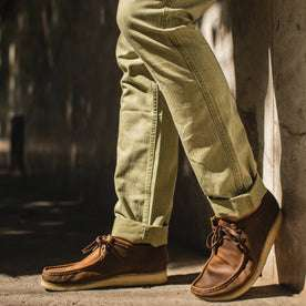 fit model wearing The Camp Pant in Olive Herringbone, cuffed with shoes