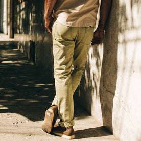 fit model wearing The Camp Pant in Olive Herringbone, back shot