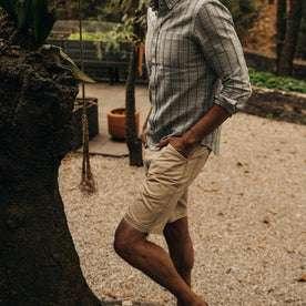fit model wearing The Camp Short in Khaki Herringbone, hand in pocket walking left