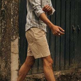 fit model wearing The Camp Short in Khaki Herringbone, walking right of camera