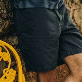 fit model wearing The Camp Short in Navy Herringbone, cropped of right leg