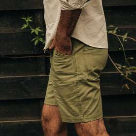 fit model wearing The Camp Short in Olive Herringbone, hand in pocket