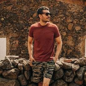 fit model wearing The Cotton Hemp Tee in Rust, hands in pockets