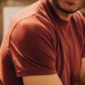 fit model wearing The Cotton Hemp Tee in Rust, sleeve shot