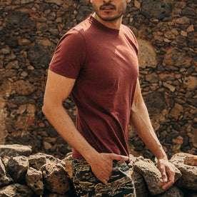 fit model wearing The Cotton Hemp Tee in Rust, hand in pocket, walking right