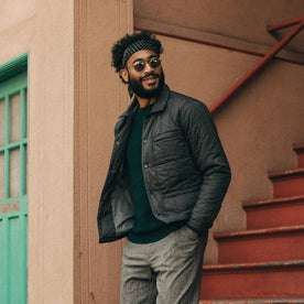 fit model wearing The Decker Jacket in Charcoal Quilt, looking right
