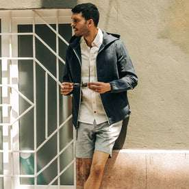 fit model wearing The Easy Short in Navy Herringbone, looking left