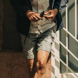 fit model wearing The Easy Short in Navy Herringbone, cropped shot chest down