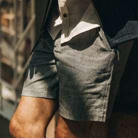 fit model wearing The Easy Short in Navy Herringbone, up close, left side
