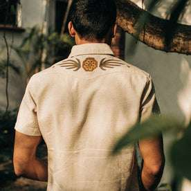 fit model wearing The Embroidered Short Sleeve Western in Natural, back shot