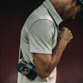 fit model wearing The Heavy Bag Polo in Natural and Ash Stripe, side shoulder shot