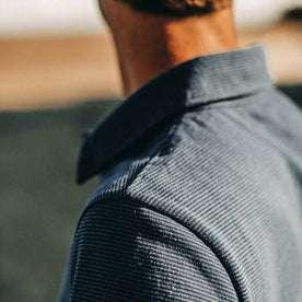fit model wearing The Heavy Bag Polo in Navy Stripe, shoulder detail